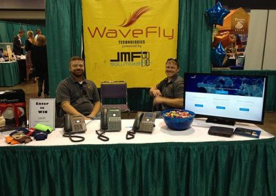 wavefly employees behind a convention booth