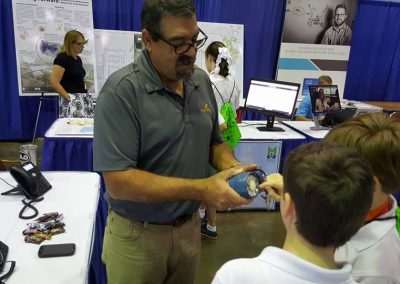 wavefly employee demoing products to kids